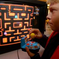 Jake Gautney of Chappaqua, New York, plays a home version of 'Ms. Pac-Man' at the Toy Industry Association holiday preview in New York in October 2004. Masaya Nakamura, considered 'the father of Pac-Man' as the founder of the video game company behind the hit game, died Jan. 22. | AP