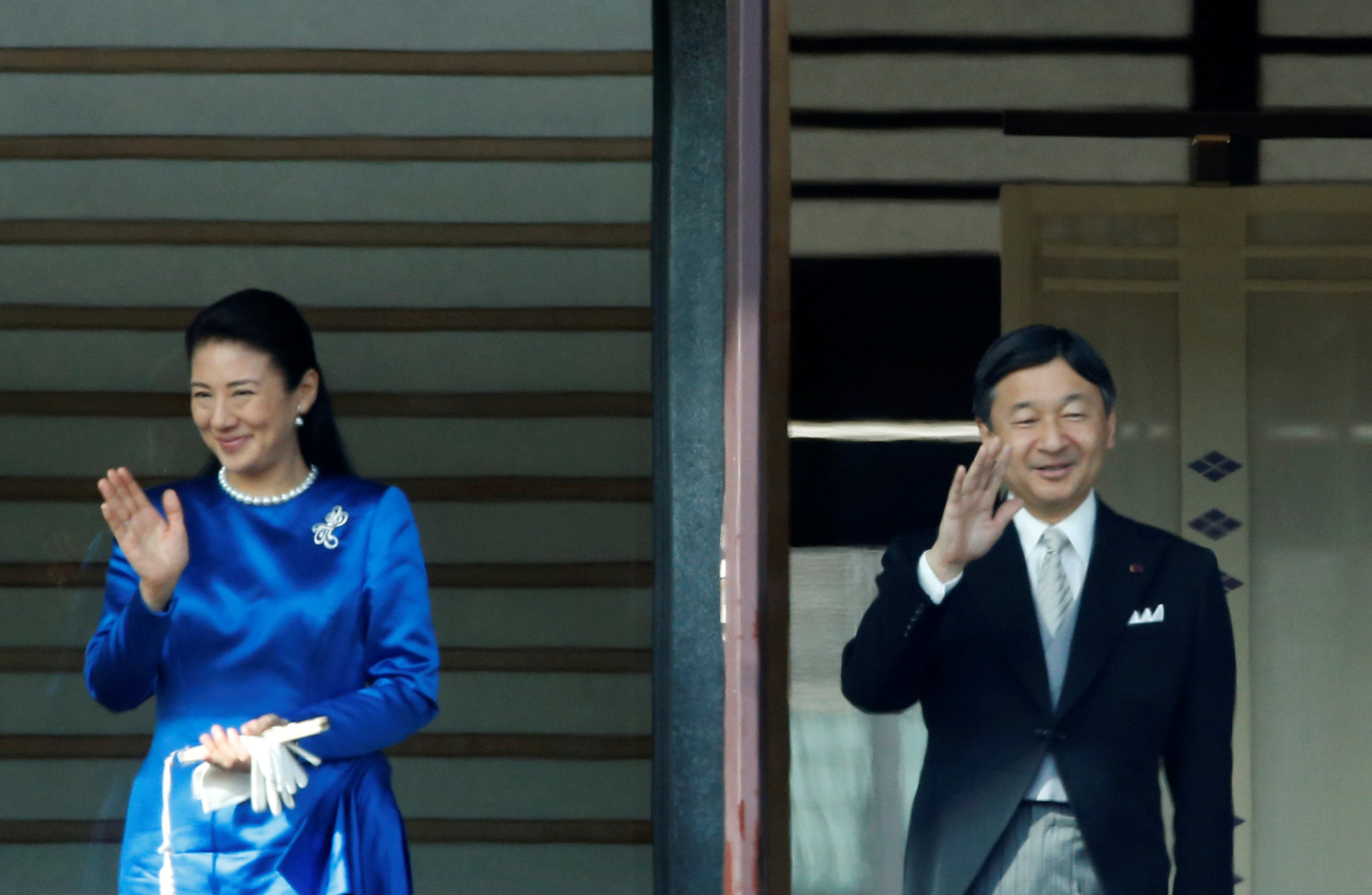 Crown Prince Naruhito and Crown Princess Masako greet onlookers during a New Year celebration at the Imperial Palace in Tokyo on Monday. | REUTERS