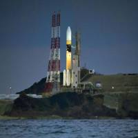 An HIIA rocket carrying the Kirameki-2 defense communication satellite stands on a launch pad at Tanegashima Space Center in Kagoshima Prefecture on Tuesday. | KYODO