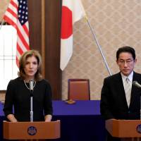 U.S. Ambassador Caroline Kennedy delivers a speech beside Foreign Minister Fumio Kishida prior to a signing ceremony at the Iikura guesthouse in Tokyo on Monday. | AFP-JIJI