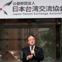 Japanese Representative to Taiwan Mikio Numata attends a name-changing ceremony for Japan's de facto embassy in Taipei on Tuesday. | REUTERS