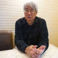 Yukihisa Fujimoto, filmmaker and co-producer of documentaries on protests over the U.S. military presence in Okinawa, is interviewed by The Japan Times in Tokyo last month. | MAGDALENA OSUMI