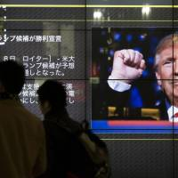 A large television in a public area in Tokyo shows a news broadcast of the Nov. 9 U.S. presidential election results. | BLOOMBERG