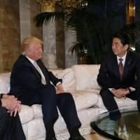 Prime Minister Shinzo Abe meets with U.S. President-elect Donald Trump at Trump Tower in New York on Nov. 17. | REUTERS