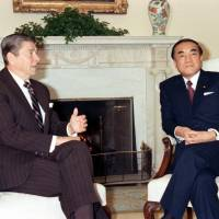 A photo taken in January 1983 shows U.S. President Ronald Reagan and Prime Minister Yasuhiro Nakasone during their first summit at the White House in Washington. | KYODO