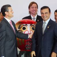 Nissan Motor Co. CEO Carlos Ghosn (second from right) and Mexican President Enrique Pena Nieto (far left) attend the opening ceremony for Nissan's new plant in Aguascalientes, central Mexico, in November 2013. | KYODO
