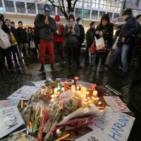 People gather in Tokyo to mourn the murders of Kenji Goto and Haruna Yukawa on Feb. 8, 2015, after news of their beheading by Islamic State group extremists was reported earlier that month. | KYODO