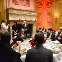 French businesspeople and journalists enjoy a full-course dinner of French dishes infused with Uji green tea at a Paris hotel on Nov. 26. | KYOTO PREFECTURAL GOVERNMENT / VIA KYODO