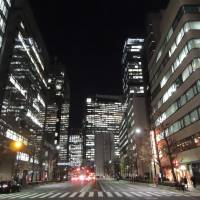 Glowing lights dot Yaesu's office high-rises after dark. | DAVEY YOUNG