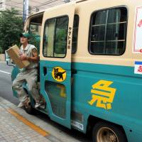 Stress mounts as fees fall in Japan for home deliveries