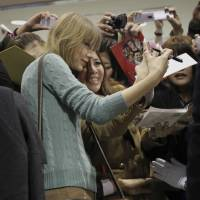 Taylor Swift has her picture taken with a fan upon her arrival at Narita International Airport near Tokyo in November 2012.   AP