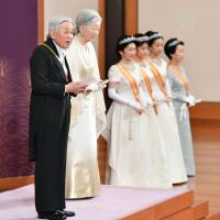 Busy itinerary: Emperor Akihito and Empress Michiko attend a New Year's ceremony at the Imperial Palace in Tokyo. The Imperial Household Agency believes such activities would make it 'difficult' for the Emperor to step down, which had been suggested by the media to happen on Dec. 31, 2018. | KYODO