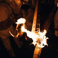 The cyprus torches bear prayers for the coming year.   LANCE HENDERSTEIN