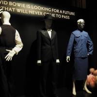 The many looks of late '70s Bowie include a skirt suit (far right) made in 1979, by Brooks Van Horn costume house for Bowie's 'Saturday Night Live' appearance.  | MARK THOMPSON