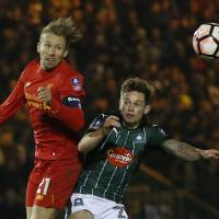 Liverpool advances in F.A. Cup