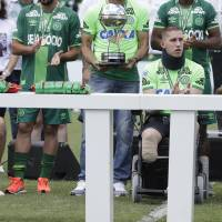 Chapecoense survivors lift trophy 2 months after tragedy
