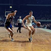Rookie guard/forward Jim Barnett of the Boston Celtics is seen playing against Jerry Lucas and the Cincinnati Royals during a game in 1967 at the Boston Garden. | NBAE/GETTY IMAGES