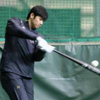 Hokkaido Nippon Ham Fighters star Shohei Otani takes some cuts in the batting cage on Friday during a workout in Kamagaya, Chiba Prefecture. | KYODO