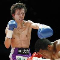Taguchi shoulders WBA title, additional responsibility