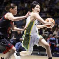 Sunflowers rookie guard Manami Fujioka drives in against the Antelopes in the annual All-Japan Championship semifinals at Yoyogi National Gymnasium on Saturday. JX-Eneos defeated Toyota Motors 72-52. | KAZ NAGATSUKA