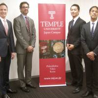 The leaders of a project exploring how collegiate athletic departments in the United States could be translated to Japan pose for a photo at Temple University Japan Campus. | KAZ NAGATSUKA