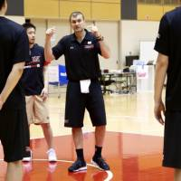 Japan men's national basketball interim head coach Luka Pavicevic instructs his players during a training session at Tokyo's National Training Center on Tuesday. | KAZ NAGATSUKA
