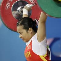 Three Chinese weightlifters lose Beijing Olympic titles for doping
