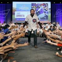 Arrieta, Harper land big deals