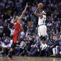 Celtics guard Isaiah Thomas shoots over Wizards guard Otto Porter Jr. during their game on Wednesday in Washington. The Celtics won 117-108. | AP
