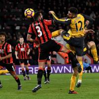 Arsenal roars back to claim dramatic draw at Bournemouth