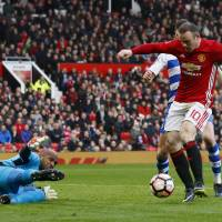 Rooney matches Charlton in rout