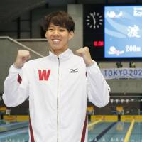 Watanabe breaks 200-meter breaststroke world record