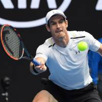 Murray eases injury worries with solid win over Querrey