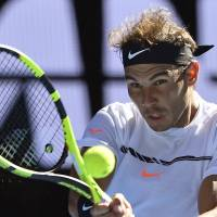 Nadal rallies past Zverev to reach fourth round