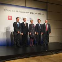 Philip Morris Japan President Paul Riley (left), Foundation Equal-Salary Founder and CEO Veronique Goy Veenhuys (center) pose with others at the ceremony held to award the Japanese unit of the tobacco giant with Equal-Salary Certification in Tokyo on Nov. 29. | MINORU MATSUTANI
