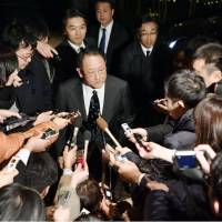Toyota Motor Corp. President Akio Toyoda fields questions from reporters Friday after a meeting with Prime Minister Shinzo Abe in Tokyo. | KYODO
