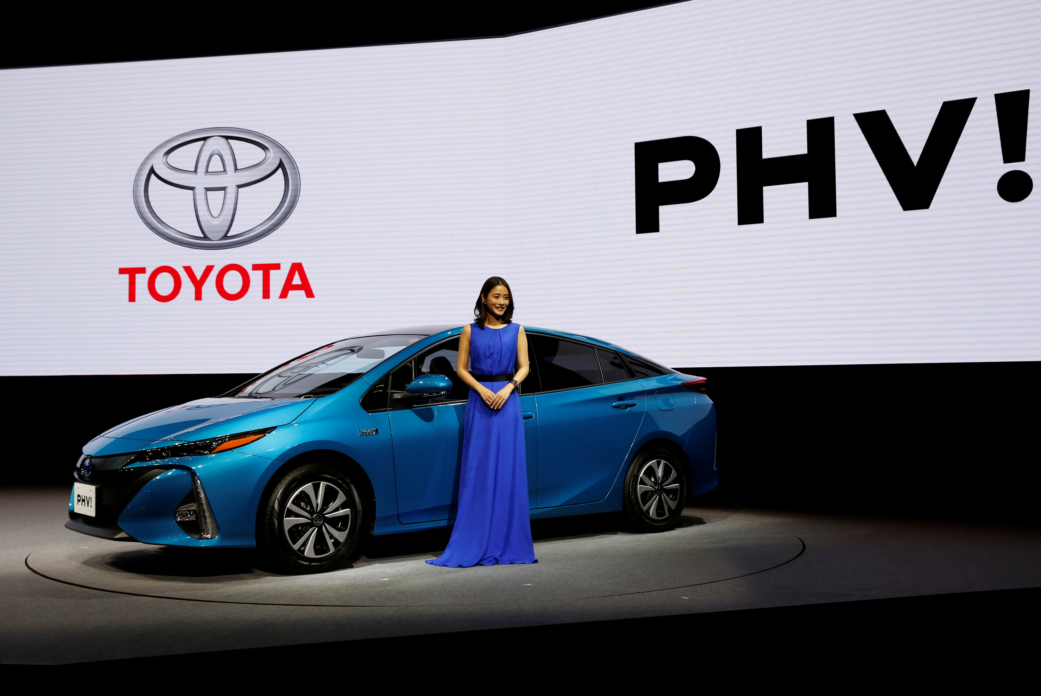 Japanese actress Satomi Ishihara poses next to Toyota's Prius PHV Plug-in-Hybrid vehicle, also known as Prius Prime in the U.S., during an event to mark the launch of the car in Japan on Wednesday. | REUTERS