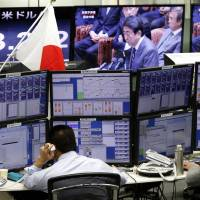 Money traders operate at a foreign exchange brokerage in Tokyo Wednesday. Japanese officials rejected U.S. President Donald Trump's claim that Tokyo is seeking to weaken the yen against the dollar to gain a trade advantage. | AP