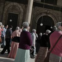 American tourists from Washington visit the Mohammed Ali Mosque, inside the medieval Salah al-Din citadel, one of the most important landmarks and tourist attractions in Cairo, on Sunday.   AP