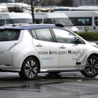 A modified Nissan Leaf driverless car is seen during its first demonstration on public roads in Europe, in London on Monday. | REUTERS