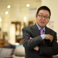 Akio Nitori, chairman and chief executive officer of Nitori Holdings Co., is interviewed at a Nitori Co. store in Tokyo earlier this month. | BLOOMBERG