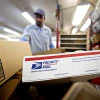 U.S. Postal Service logs $200 million loss over holiday season but parcel biz up