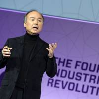 SoftBank boss Masayoshi Son delivers the keynote speech at the Mobile World Congress in Barcelona, Spain, on Monday. | AFP-JIJI