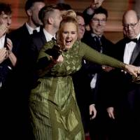 Adele sweeps Grammys Awards with 5 wins, while David Bowie wins 4