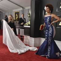Singer Joy Villa wears a 'Make America Great Again' gown to the 59th Grammy Awards on Feb. 12. | AP