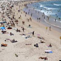 Australia battles 50 fires in heat wave; blackout feared