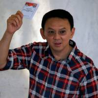 Unofficial tally points to runoff vote for governor of Indonesia capital
