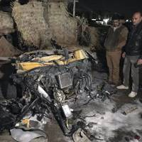 55 killed in Islamic State car bombing at Baghdad auto dealer