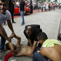 President sends in troops as violence, murder descend on Brazil state amid police strike over pay
