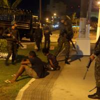 Brazil troops patrol restive city as crime wave death toll hits 70 amid military police strike